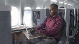 image of man sitting in Business class