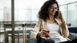 image of woman on phone in airport