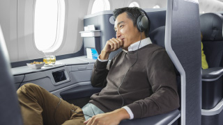 image of man sitting in Business class seat