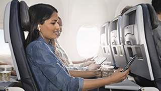 image of women using Wi-Fi on the airplane